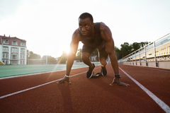 Fit confident african sportsman standing in starting position Royalty Free Stock Photo