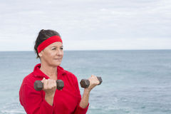 Fit Confident senior woman exercising outdoor Royalty Free Stock Photography