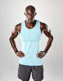 Fit and confident young muscular african man Stock Photos