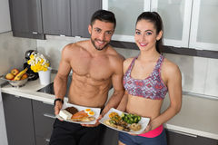 Fit couple - animal versus plant proteins Royalty Free Stock Photography