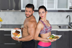Fit couple - animal versus plant proteins Royalty Free Stock Images