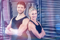 Fit couple with arm crossed Stock Images