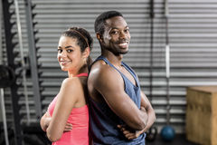 Fit couple back to back Royalty Free Stock Photos