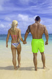 Fit couple at the beach Royalty Free Stock Photos