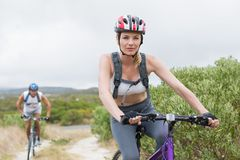 Fit couple cycling on mountain trail Royalty Free Stock Photo