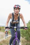 Fit couple cycling on mountain trail Stock Photography