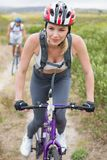 Fit couple cycling on mountain trail Stock Photos