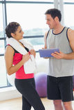 Fit couple with at digital table in exercise room Stock Image