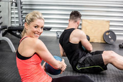 Fit couple doing abdominal ball exercise. At crossfit gym royalty free stock image