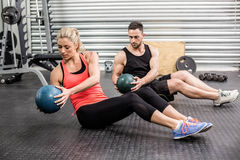 Fit couple doing abdominal ball exercise stock photos