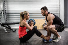 Fit couple doing abdominal ball exercise Stock Images