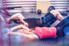 Fit couple doing abdominal ball exercise. At gym Royalty Free Stock Photography