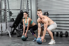 Fit couple doing ball exercise Stock Images