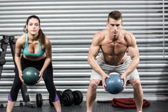 Fit couple doing ball exercise Royalty Free Stock Image