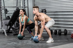 Fit couple doing ball exercise Royalty Free Stock Photography