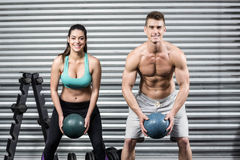 Fit couple doing ball exercise Stock Image