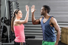 Fit couple doing high five Stock Image
