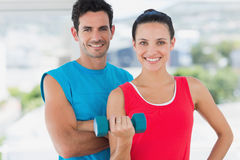 Fit couple with dumbbell in bright exercise room Stock Photography