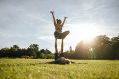 Fit couple exercising acroyoga in park Royalty Free Stock Photography