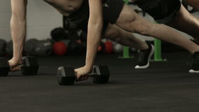 Fit couple exercising with dumbbells. In crossfit gym stock video