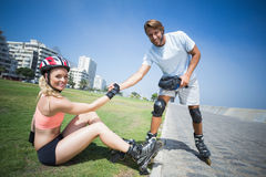 Fit couple getting ready to roller blade Royalty Free Stock Photo