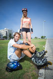 Fit couple getting ready to roller blade Royalty Free Stock Image