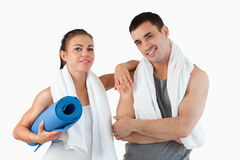 Fit couple going to practice yoga. Against a white background Stock Image