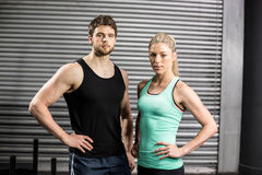 Fit couple with hands on hips Royalty Free Stock Photography