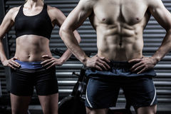 Fit couple with hands on the hips Stock Images