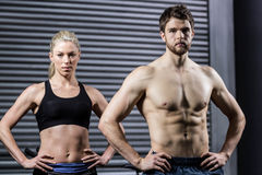 Fit couple with hands on the hips Royalty Free Stock Photo