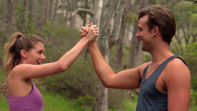 Fit couple high fiving during jogging stock video