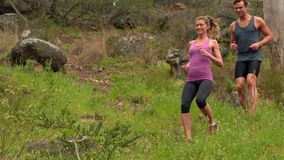 Fit couple high fiving during jogging stock footage