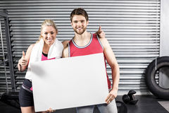 Fit couple holding blank paper Stock Photo