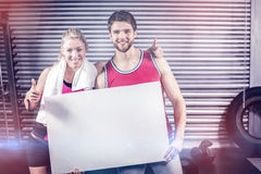 Fit couple holding blank paper Stock Photos