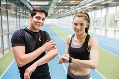 Fit couple on the indoor track Stock Images