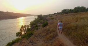 Fit couple jogging together on a trail in the countryside stock video