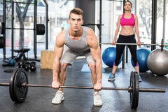 Fit couple lifting barbell Royalty Free Stock Photography