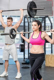 Fit couple lifting barbell Royalty Free Stock Images