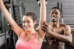Fit couple lifting dumbbells Royalty Free Stock Photo