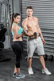 Fit couple lifting dumbbells Stock Photos
