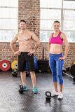 Fit couple looking at the camera Royalty Free Stock Images