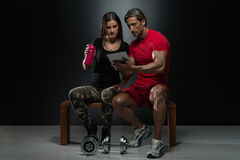 Fit Couple Looking At Digital Table Stock Photos