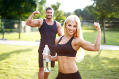Fit couple in nature with bottle of water Royalty Free Stock Photography