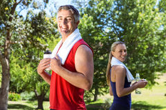 Fit couple in the park Stock Photos