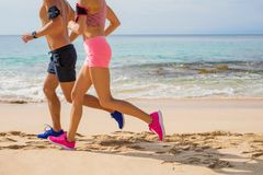 Couple run together on the beach Royalty Free Stock Photography
