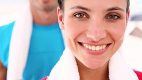 Fit couple smiling at camera. At the gym stock video