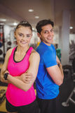 Fit couple smiling at camera. At the gym Royalty Free Stock Photo