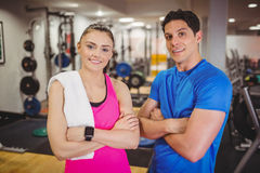 Fit couple smiling at camera. At the gym Stock Photography