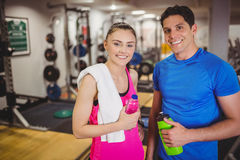 Fit couple smiling at camera. At the gym Royalty Free Stock Image