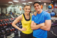 Fit couple smiling at camera. At the gym Stock Photo